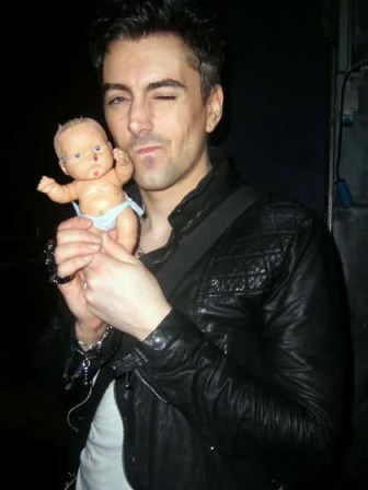 Ian Watkins holding baby doll in Dublin May 18, 2010. Credit: WENN.com