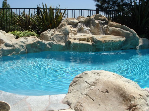 Swimming pools and fish ponds rockscapes unlimited for Koi pond and swimming pool