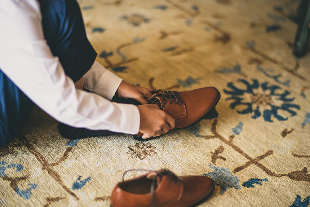 Ring Bearer putting shoes
