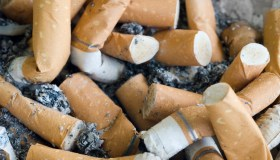 Close-Up Of Burnt Cigarettes In Ashtray