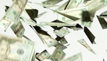 CU, Twenty dollar bills falling against white background