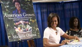 US First Lady Michelle Obama signs her b