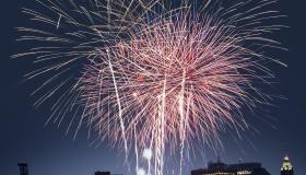 Fourth of July celebration over New York skyline at night
