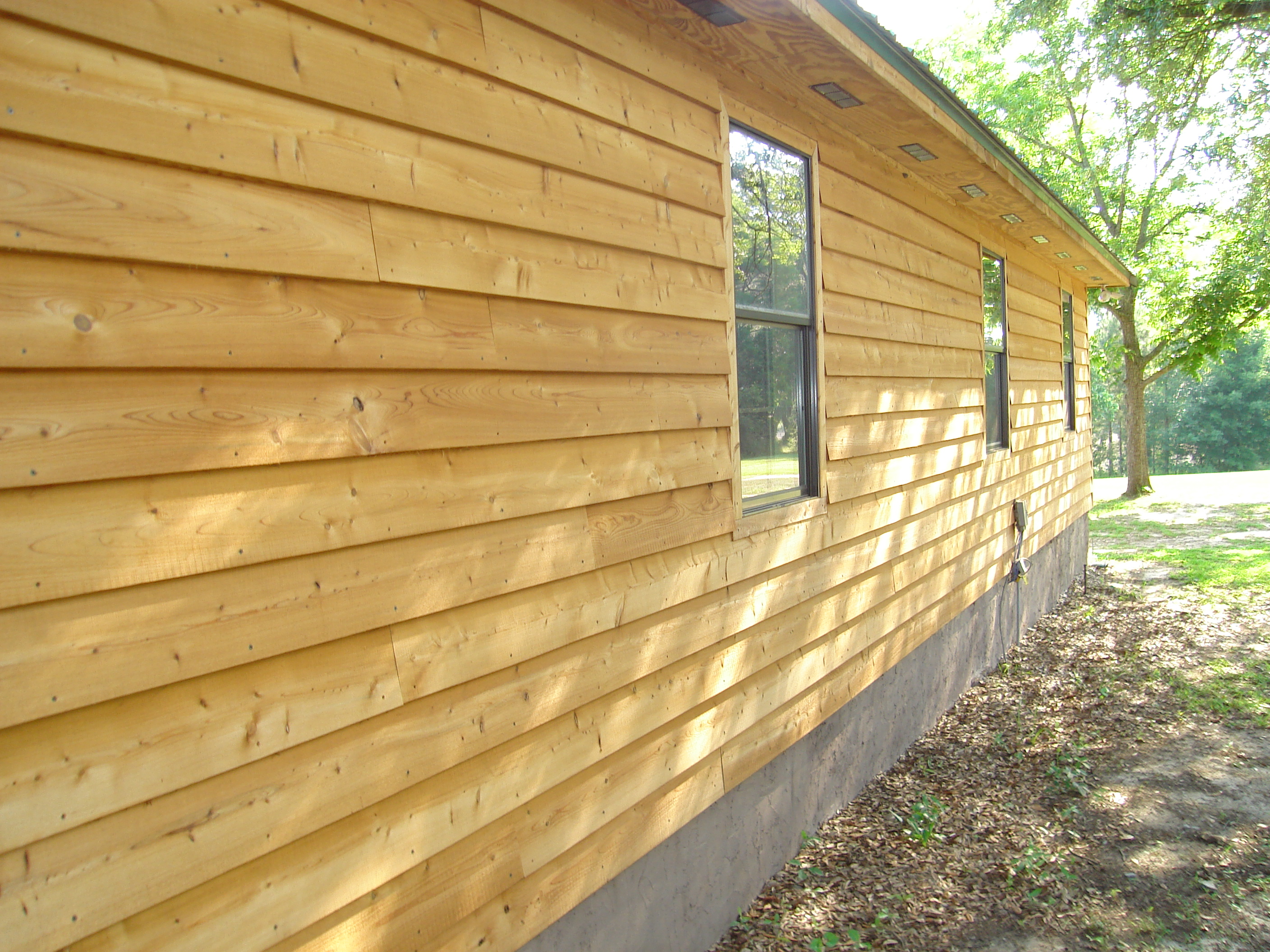 Virginia roofing siding company wood siding for Natural wood siding