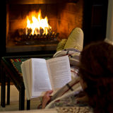 woman-reading-fireplace-23316647