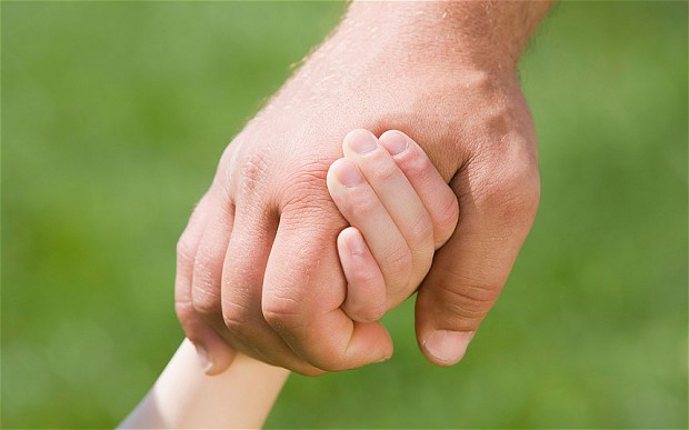 Man-and-child-hold_2409462b