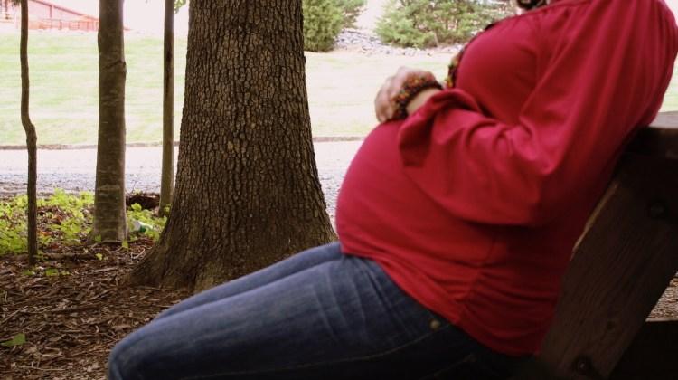 Sitting woman pregnant