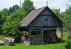 Kozolec - Wooden hayrack barn with a red tractor, Bela Krajina, Slovenia - www.rossiwrites.com