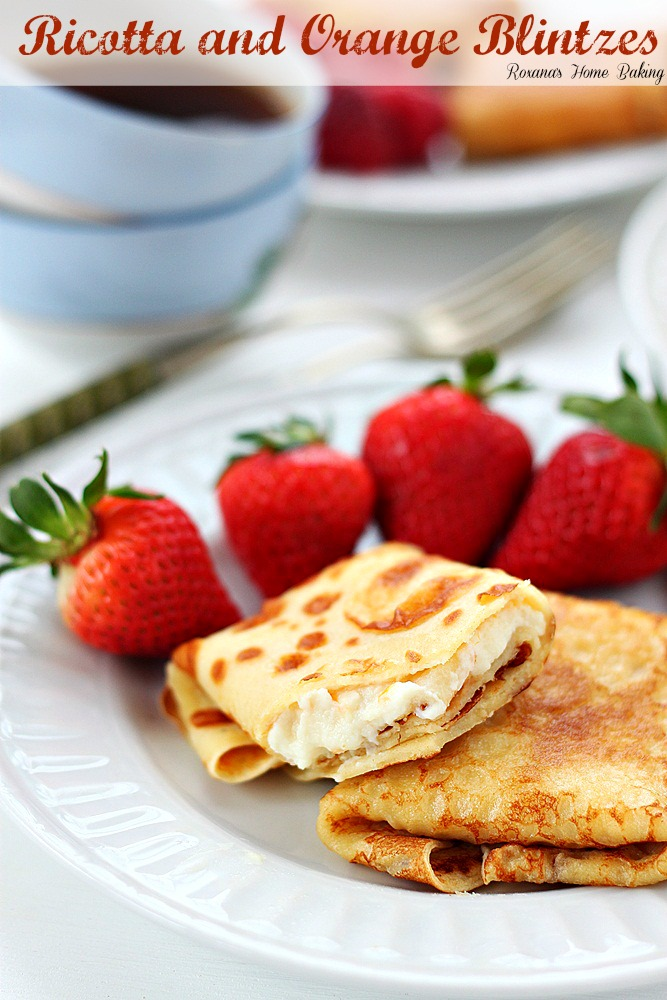 Ricotta and orange blintzes from Roxanashomebaking.com Thin crepes filled with sweet ricotta with a touch of orange
