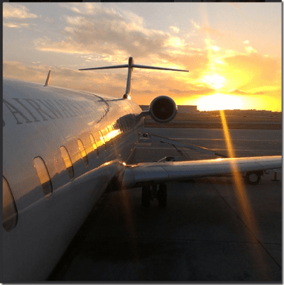 sunset and an airplane thumb Healthy Business Travel with National Car Rental