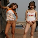 Two teen girls posing naked at public