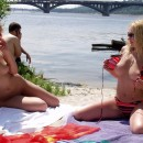 Two busty blondies plays naked with ball at the beach