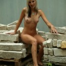 Lovely russian blonde teen wit sporty body posing naked outdoors