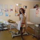 Sexy russian girl posing in sexy dress at a doctor's office