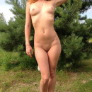 Sporty redhead with tattoo on perfect body outdoors