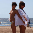 Two russian girls posing topless at public beach