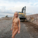 Russian blonde teen with very small tits teases workers at construction site