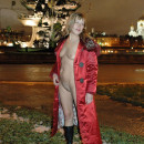 Russian girl with very small tits flashes her body at center of Moscow at winter