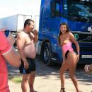 Shameless teen posing naked in front of truckers