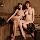 Two busty teens at sauna with no clothes