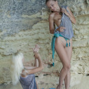 Two young lesbians lick each other  big pussy in cave