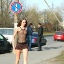 Crazy Russian beauty in a transparent top with nipples standing in a very public place