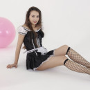 Skinny teen model posing with balloons in the studio