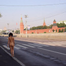 Hot russian brunette with ideal body and big boobs posing naked in front of Kremlin