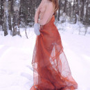 Perfect russian babe posing at winter forest