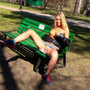 Beautiful smiling blonde with slender body flashing at public