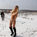 Thin blonde with a clean-shaved snatch in the snow at the construction site