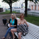 Russian flasher Inna undressing at city square