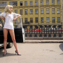 Russian amateur blonde undresses on the square