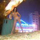 Naked brunette at Moscow summer night