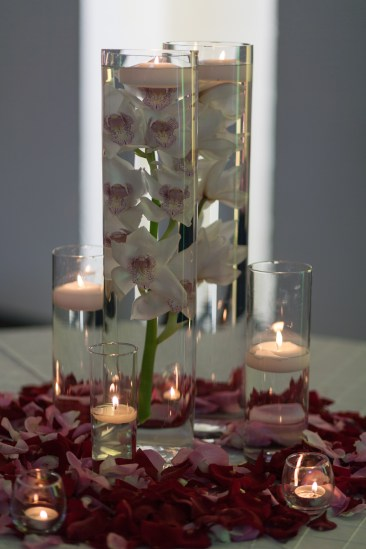 Awesome table display of iris flowers and candles in crystal vases
