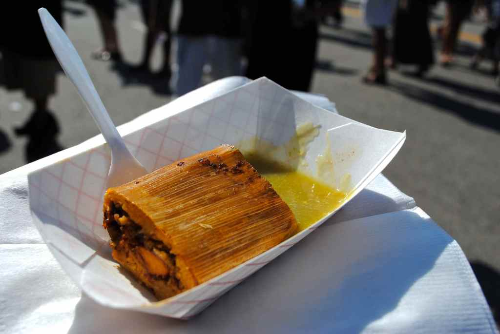 The half of pork tamale was served up with a spicy salsa verde.