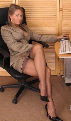 crossed legs sitting office chair