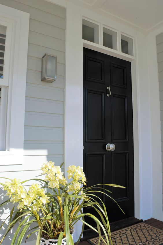 Hamptons style traditional coastal home with black door white trim and very soft gray color
