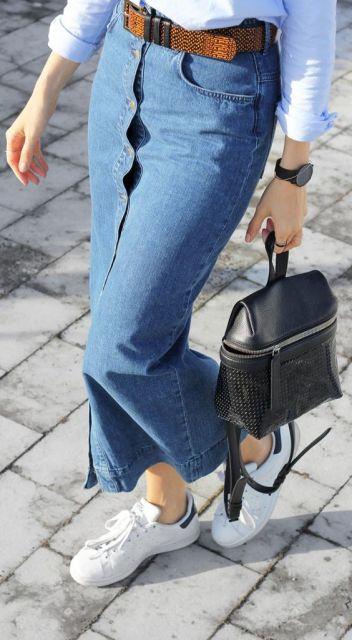 Joyce Croonen is wearing a button front long denim skirt from H&M: