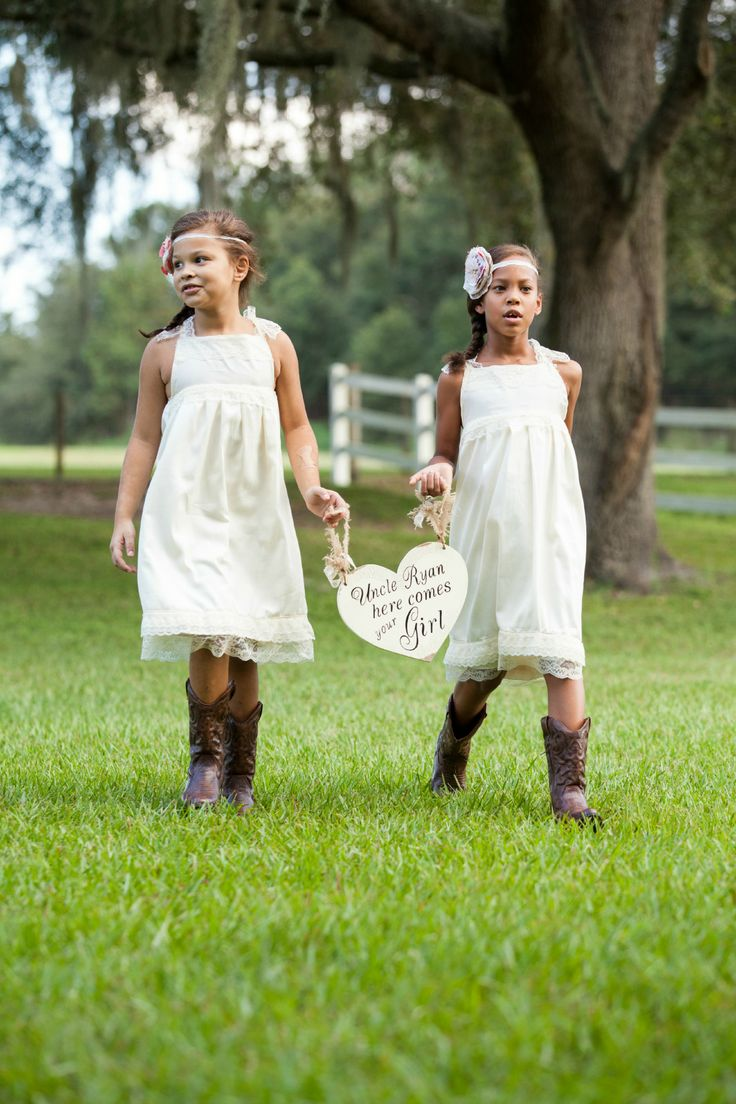 flower girl ring bearers country girl wedding dresses Rustic flower girls in simple lace dress and cowboy boots from our rustic themed fall wedding