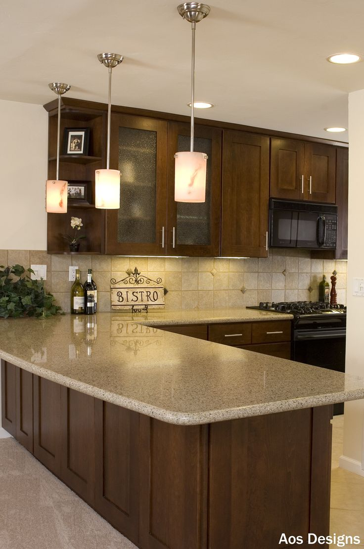 kitchen ideas countertop kitchen Those who love large granite counters pendant and undercabinet lighting can t help but fall in love with this DIY kitchen remodel