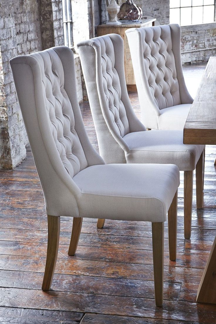 upholstered dining chairs rolling kitchen chairs Upholstered winged chairs will give your dining room an air of elegance We love