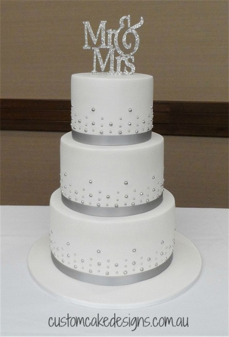 wedding cake designs wedding cakes pictures Mr Mrs Wedding Cake This elegant and simple design was chosen by the bride to match their silver and white wedding theme This cake