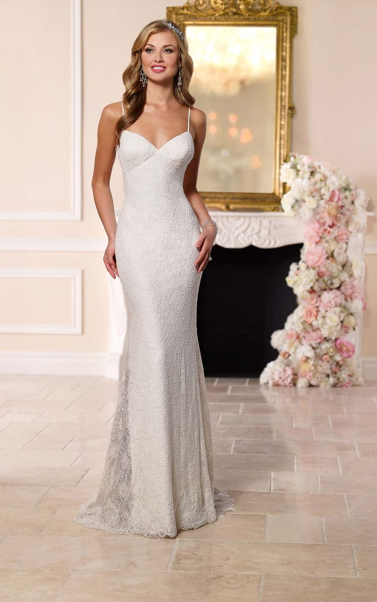 stella york jamaican wedding dresses This head turning lace and Imperial crepe sheath dress from Stella York hugs the body and features sexy spaghetti straps and a dramatic low back