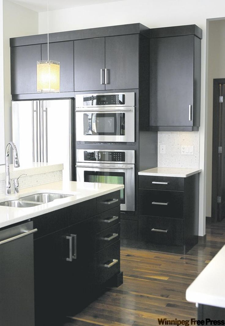 kitchen small kitchen white cabinets Dark expresso cabinets topped with white quartz countertops create drama in the kitchen