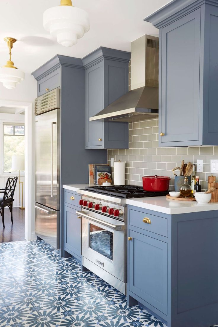 painted kitchen cabinets repainting kitchen cabinets Benjamin Moore Wolf Gray painted kitchen cabinets with patterned floor tile and gray subway tile backsplash