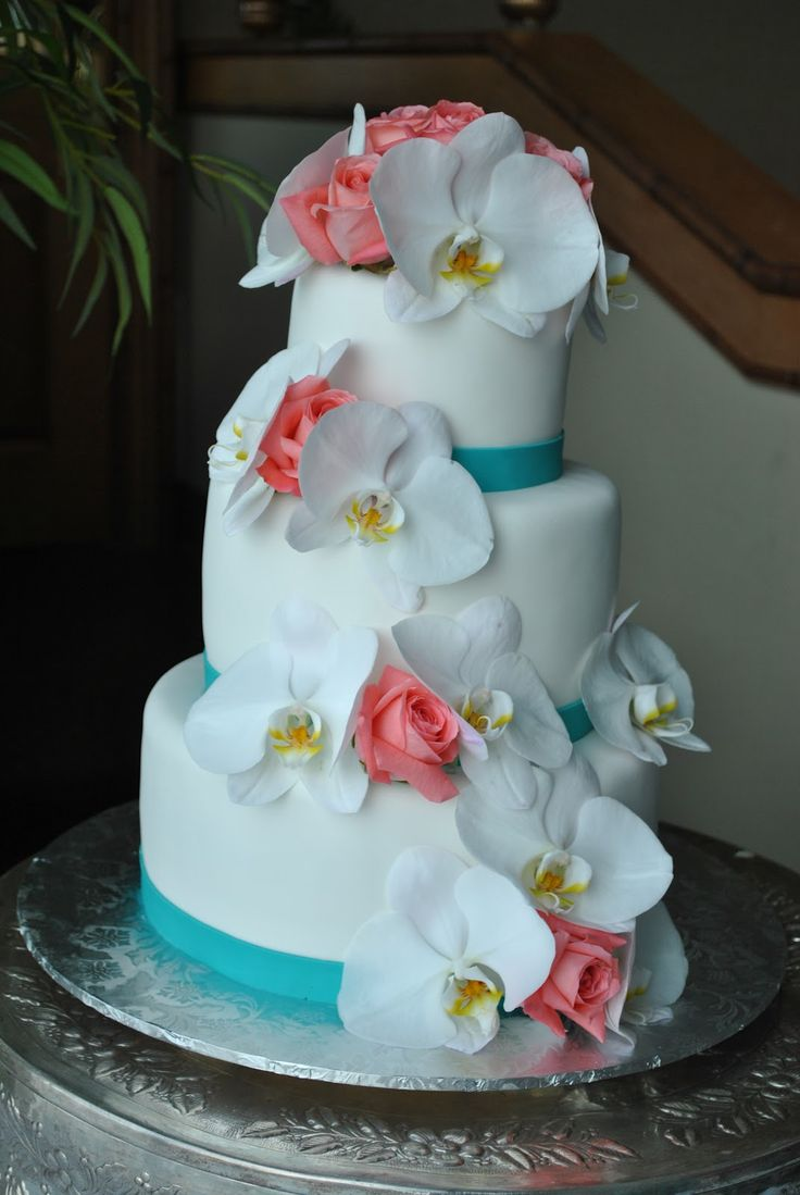 beach wedding cakes wedding cakes pictures White orchids and coral roses wedding cake by The cake Zone