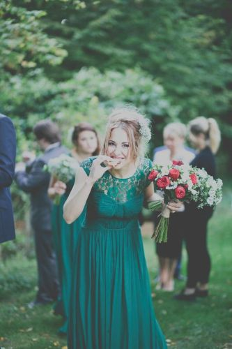 emerald wedding dresses green wedding dress A Maggie Sottero Wedding Gown with gypsophila baby s breath flower crown for a wedding at Cripps Barn including Coast forest green bridesmaid dresses