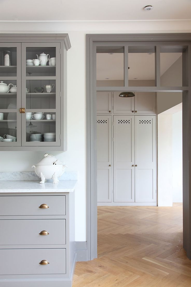 grey trim light gray kitchen cabinets Gray kitchen cabinets brass hardware herringbone floor