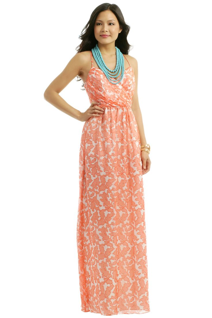 beach wedding destination wedding guest dresses Coral maxi dress for a wedding guest Wear this printed maxi dress to a casual daytime wedding a beach wedding or a destination wedding